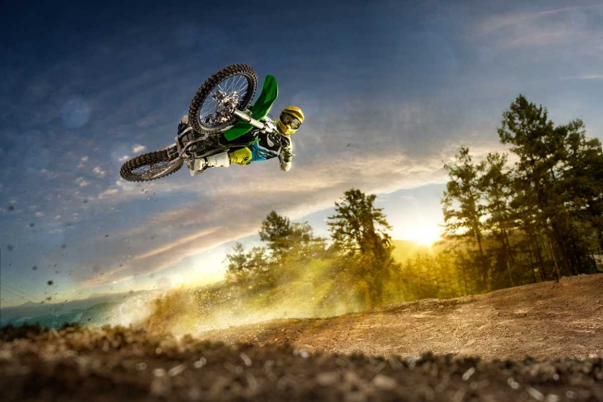 Dirt bike rider is flying high in evening
