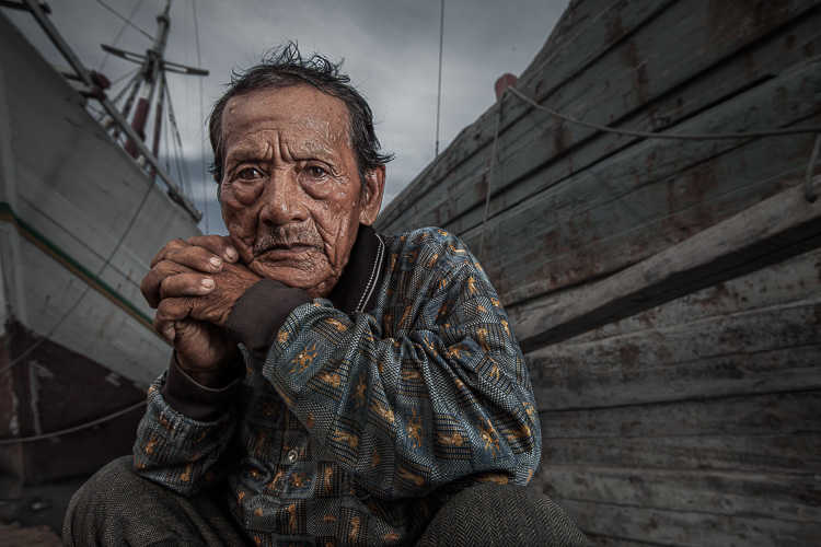 Dock worker in a Jakarta shipyard poses for the camera.